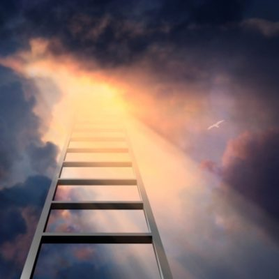 Ladder climbing to dramatic sky