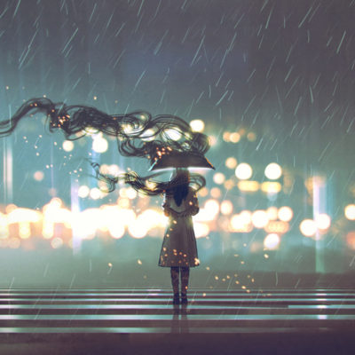 Woman with umbrella standing in the storm