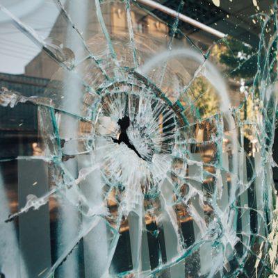 Window brokern during a violent insurrection