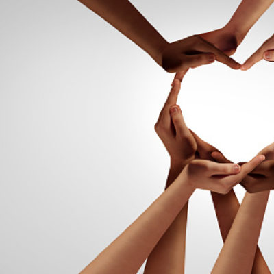 Unity and diversity partnership as heart hands in a group of diverse people connected together