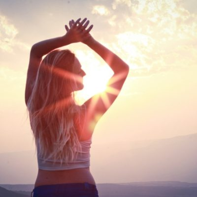 Woman stretching in morning with sun