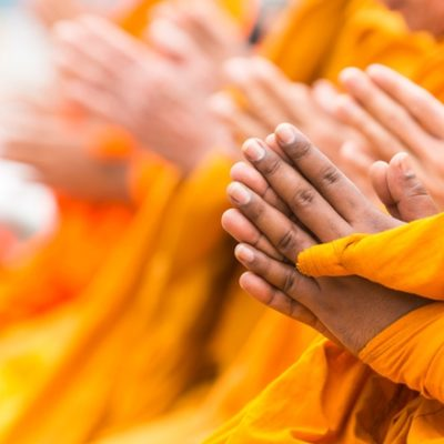 Monks with hands in namaste