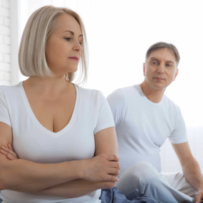 Middle age couple in bed feeling tense