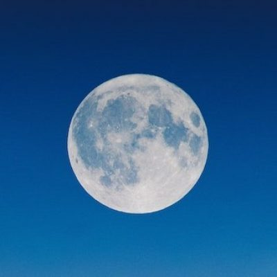 Full moon on a dark blue night sky