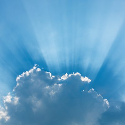 blue sky and clouds with silver linings of light to symbolize pandemic silver linings