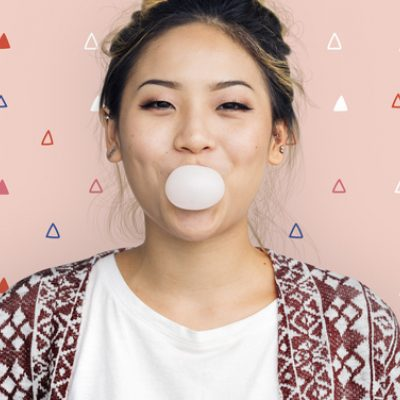 A woman blowing gum illustrates the concept of embracing circles for emotional sustainability