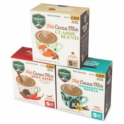 cbd hot cocoa mixes stacked in a pyramid