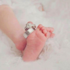 Image of baby feet with rings.
