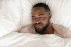 Man does breathwork for better sleep