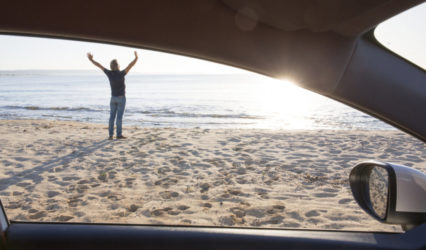 Man Stretches Outside Car