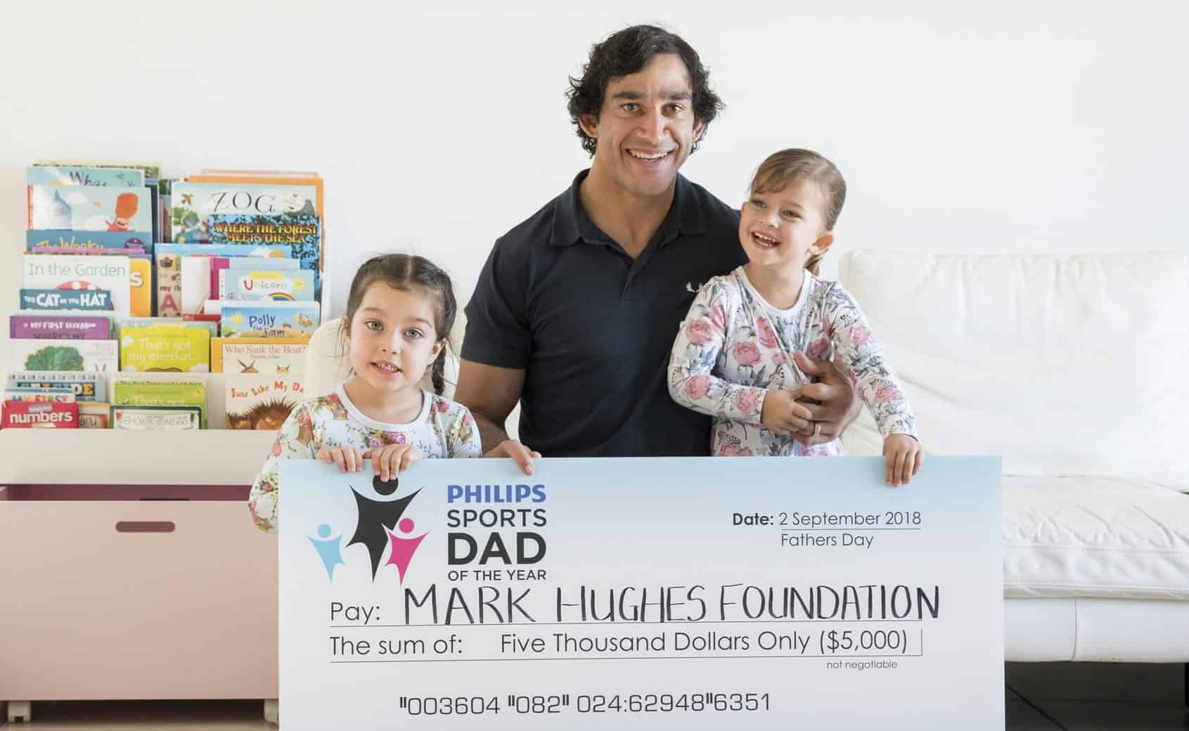 Jonathan Thurston showing off his win with his family.
