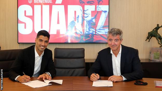 LUIS SUAREZ SIGNS TWO-YEAR CONTRACT WITH ATLETICO