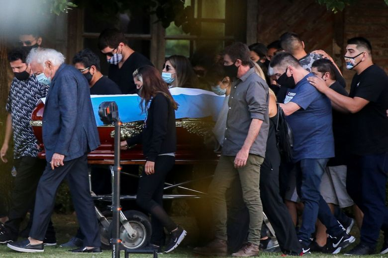 FUNERAL WORKER FIRED FOR POSING WITH MARADONA'S BODY