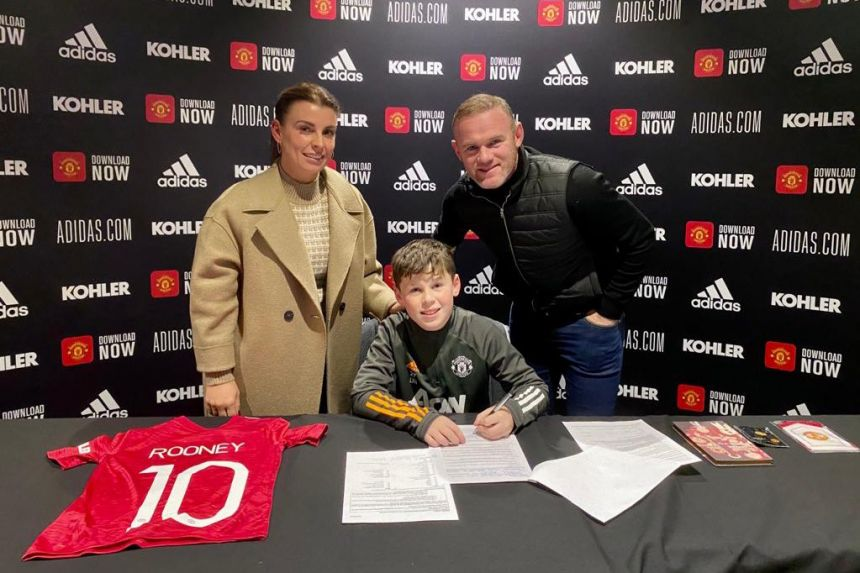 LIKE FATHER LIKE SON AS WAYNE ROONEY'S SON SIGNS FOR MAN UNITED