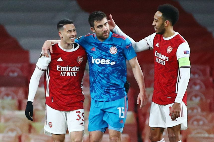 ARSENAL STAGGER INTO EUROPA LEAGUE QUARTERS AS SPURS COLLAPSE