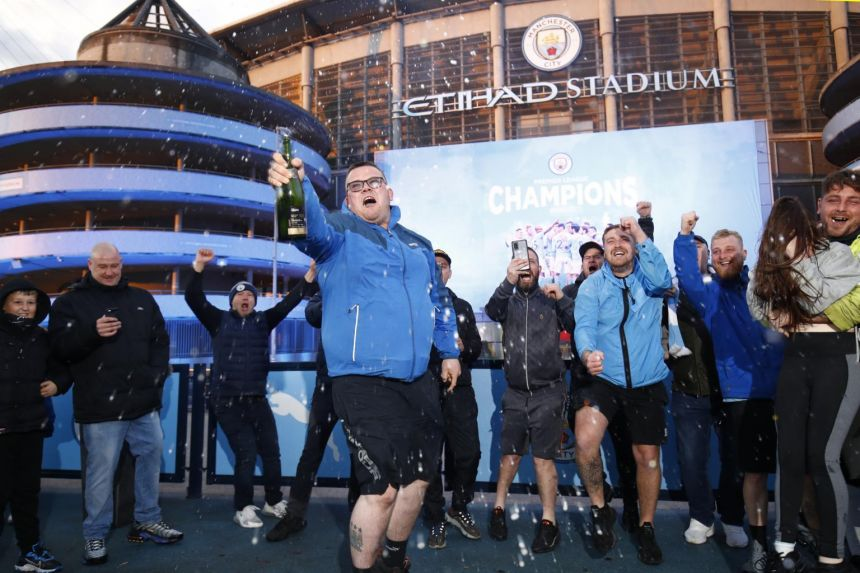 MANCHESTER CITY FANS GATHER TO CELEBRATE PREMIER LEAGUE TITLE GLORY