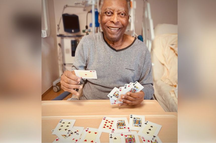 Football great, Pele playing cards, smiling after surgery