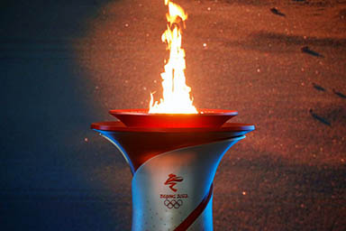 Beijing lights flame, to be first city to host summer, winter Olympic Games