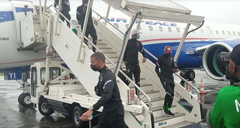 Like wounded lions, Super Eagles land in Douala