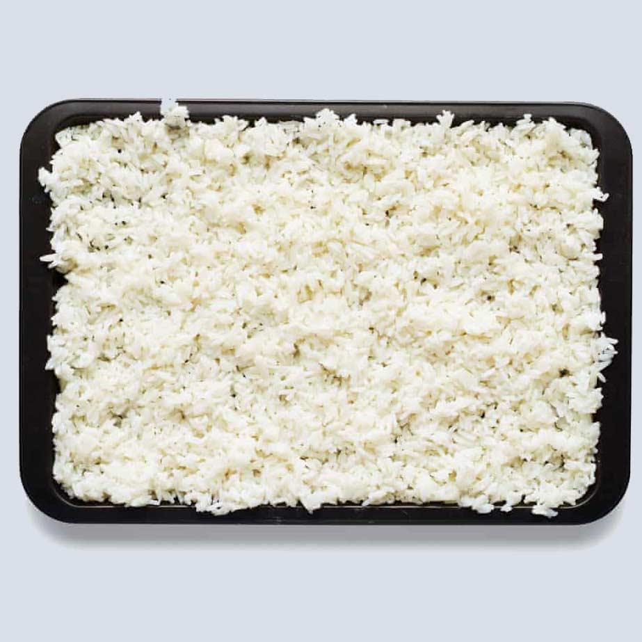 cold rice on a baking sheet