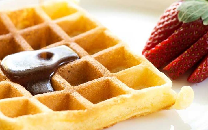 Waffles with Brown Sugar Butter Syrup. Soft, fluffy waffles drizzled generously in a rich brown sugar butter syrup. Perfect for a special/weekend breakfast.