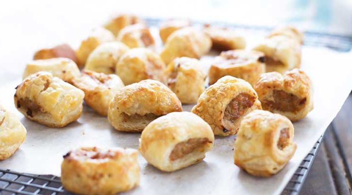 These sausage rolls use chicken rather than the more traditional pork mince. They also contain 4 vegetables and hidden lentils, all wrapped up inside flaking puff pastry. So simple to make, you will wonder why you ever bought them! | Sprinkles and Sprouts