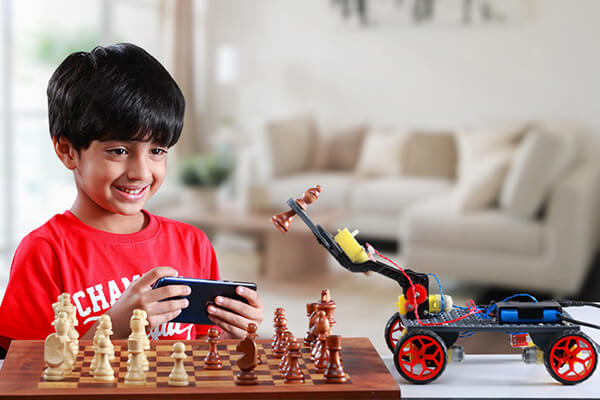 Child with Ranger Kit, learning Electronics and Mechanics, for age 9+ years