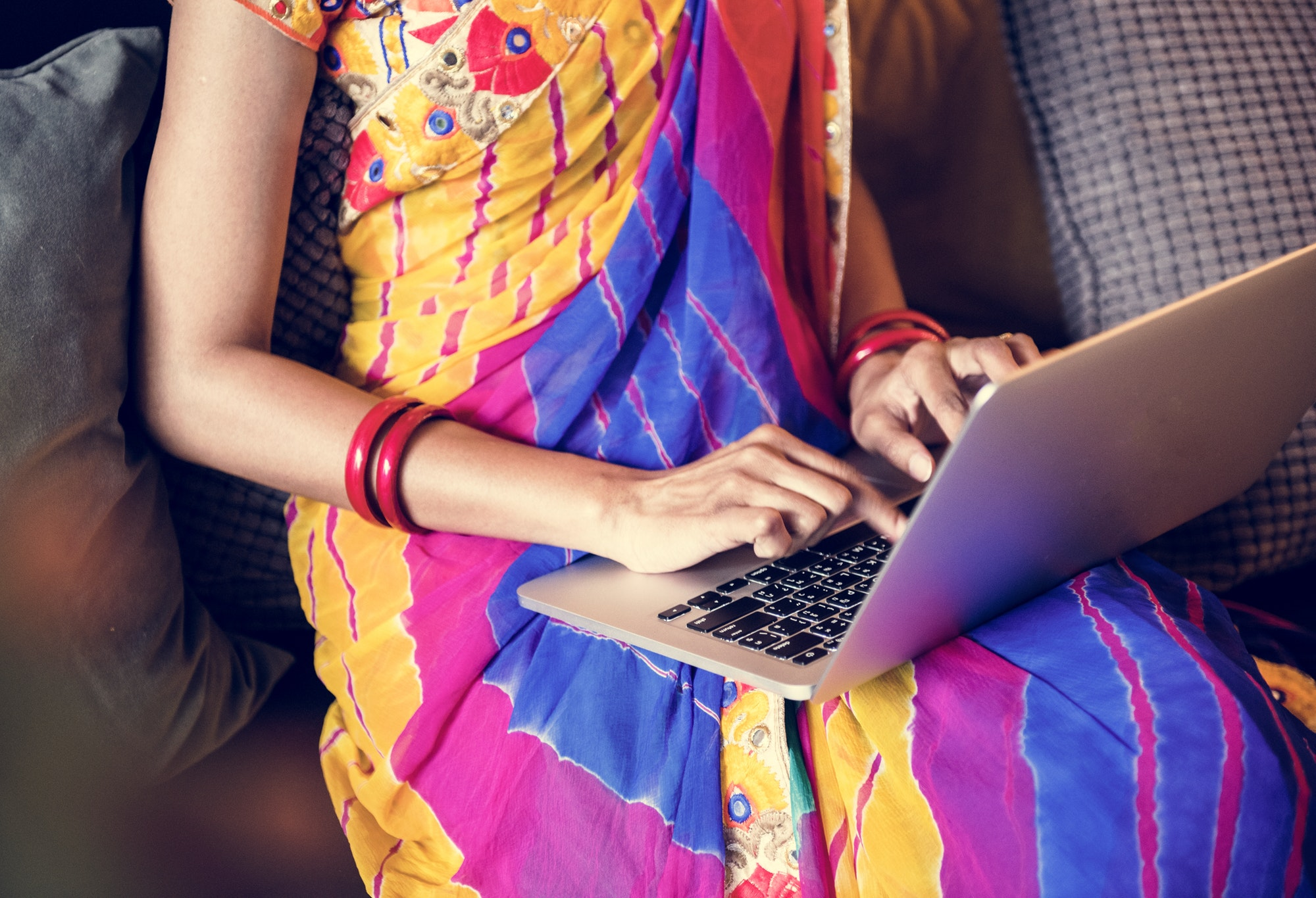 Indian woman is using computer laptop