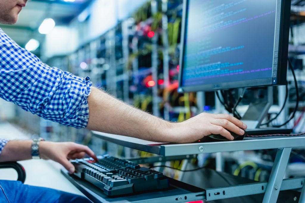 IT specialist working in bitcoin and crypto currency mining farm