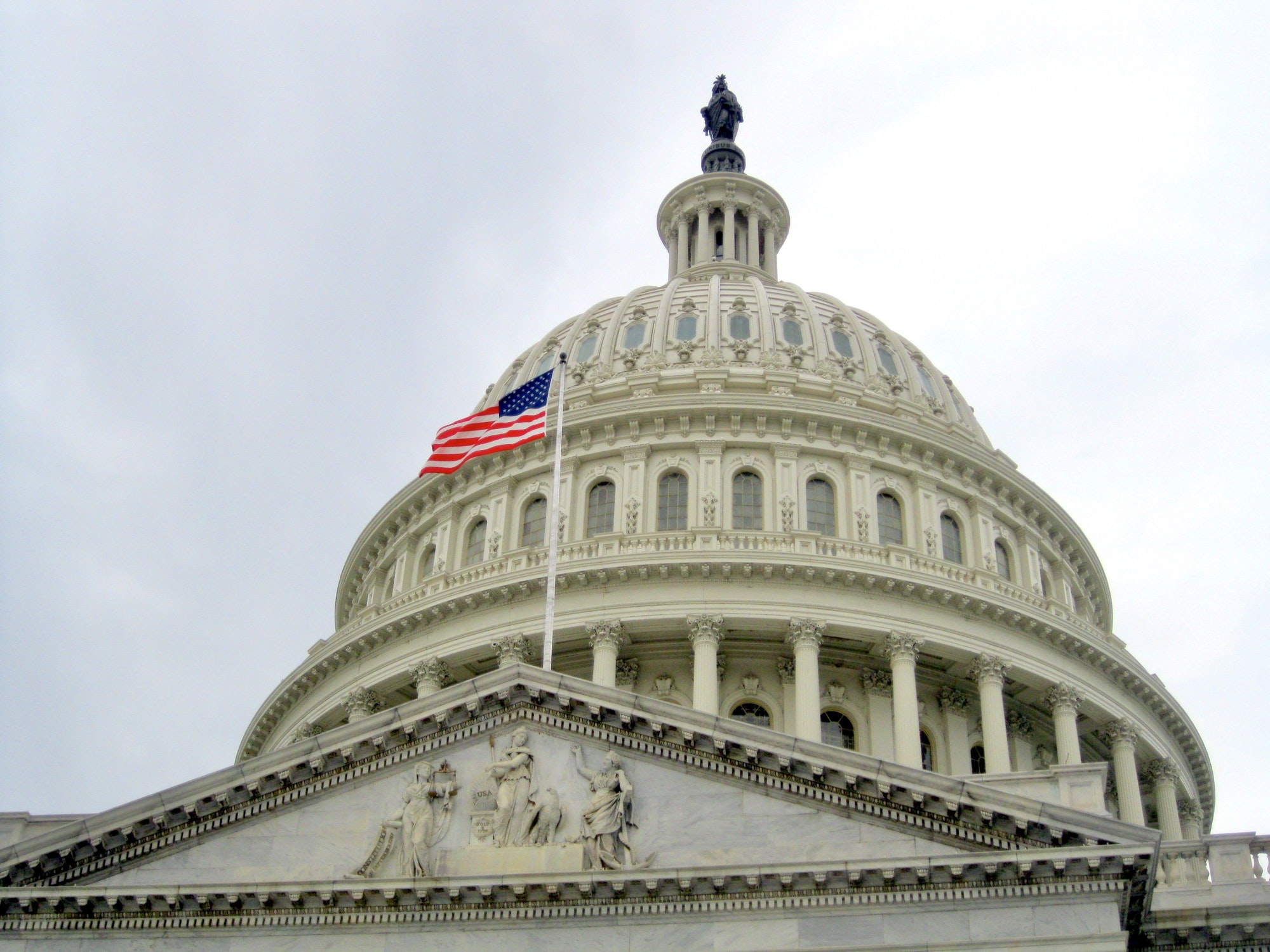 View of the Capitol Building Dome with the United States flag. Washington D.C. USA travel
