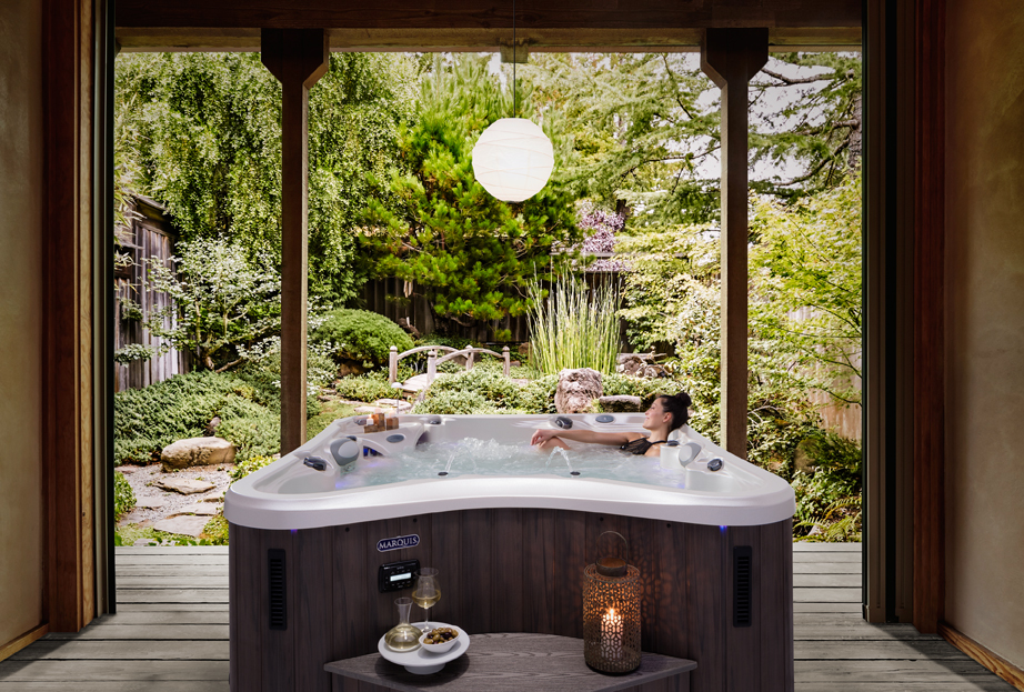 A backyard spa retreat with a Marquis hot tub