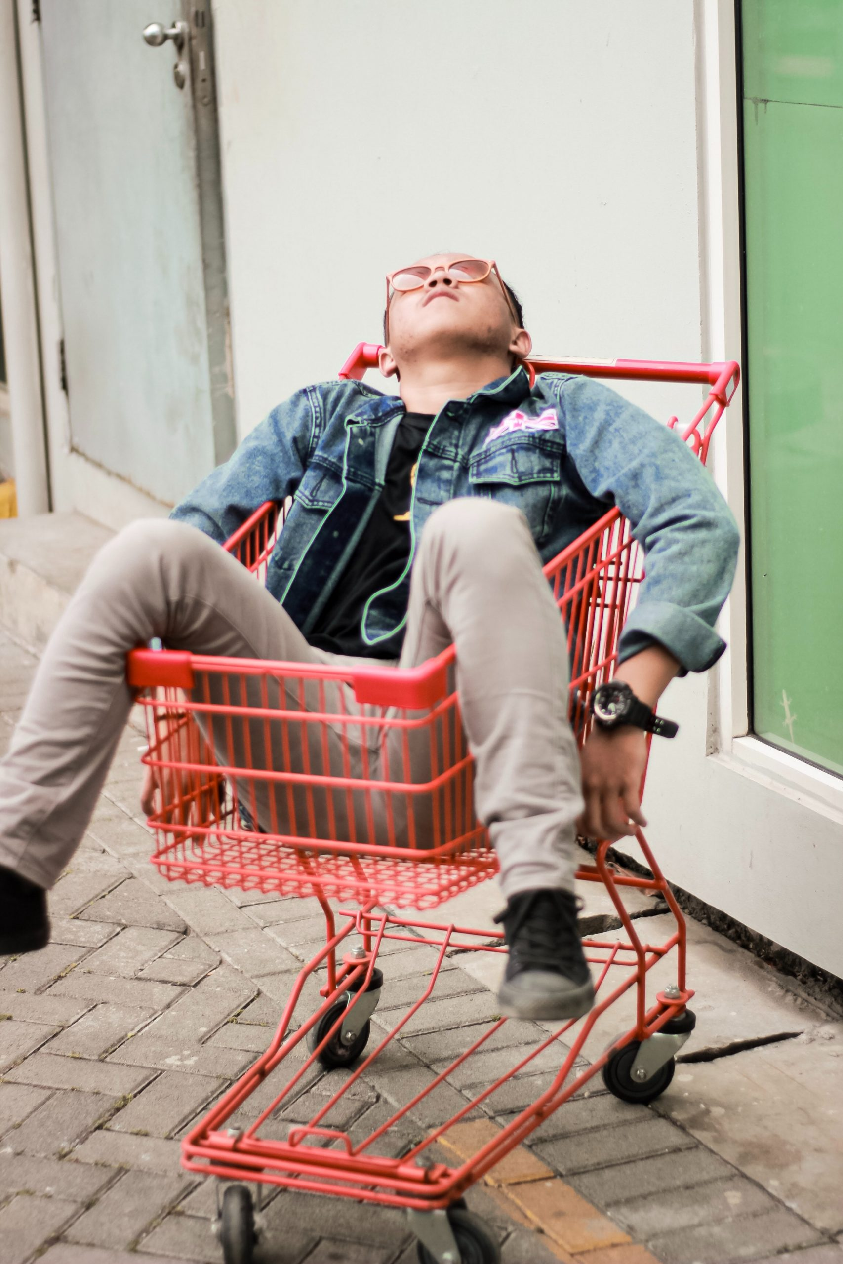 Man relaxing on a shopping trolley