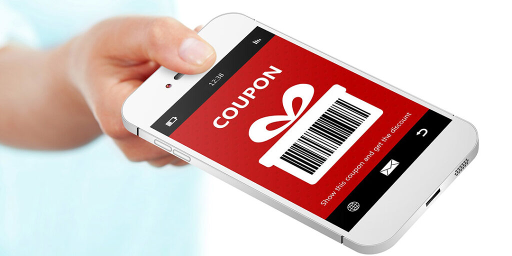 A mobile in hand with coupon on the screen