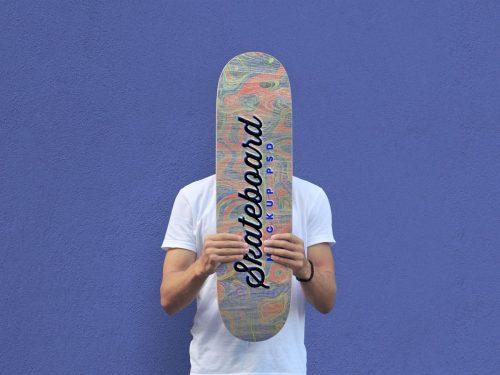 Asset | Free Man Holding Skateboard Mockup PSD | Designbolts