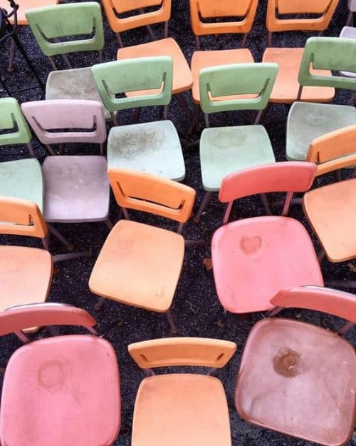 Rustic pastel chairs from an old school room.