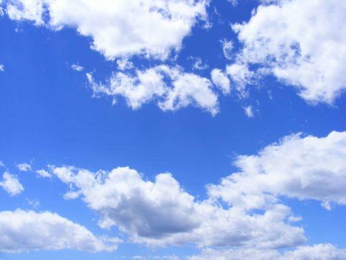 Cumulus clouds with bright . blue sky