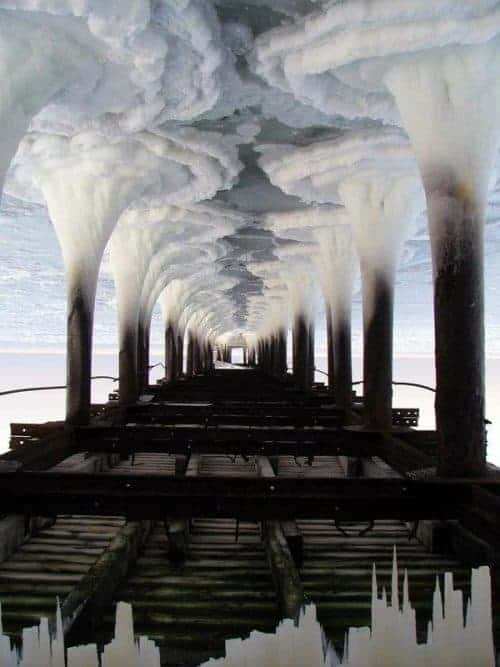 Frozen Water Under a Pier – Smoke Stacked Industrial Cityscape – Optical Illusion
