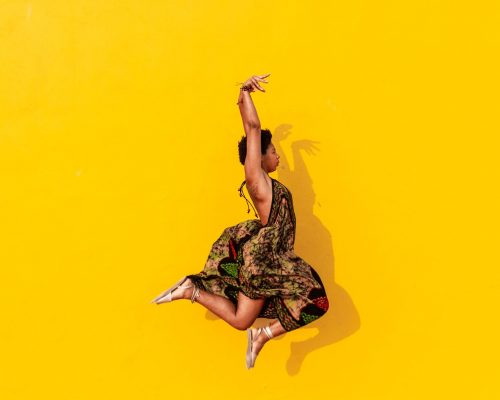 beautiful vibrant photography – african model on yellow background
