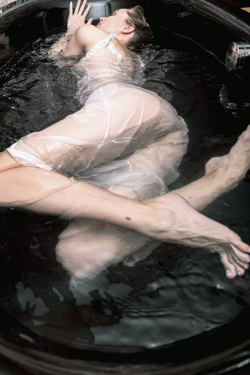 Floating ghost Soaking Wet In a Bath Tub Erotic Model Photography