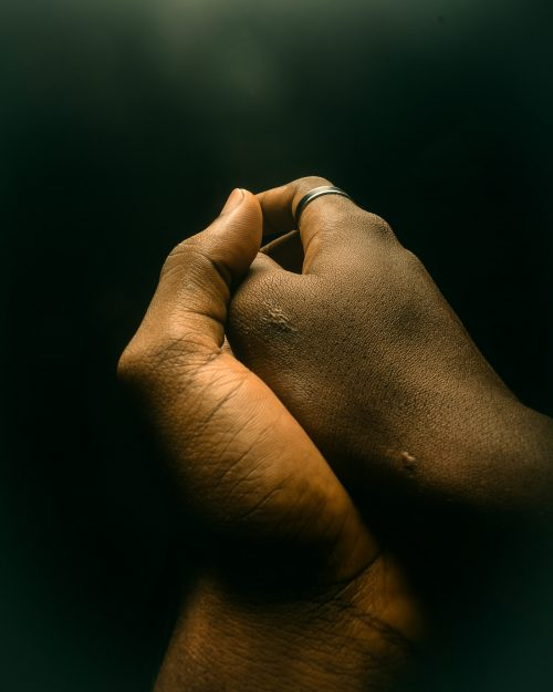 different kind of handshake -Close up Photography of black and brown hands
