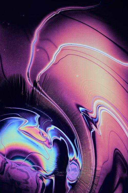 metallic chromatic chemical reactions shot sci fi inspired macro photography texture vaporwave