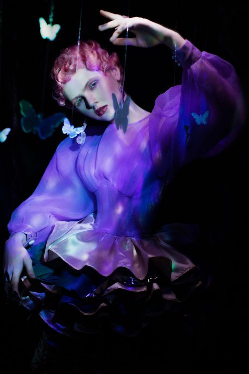 Dark whimsical magical floating flowers fashion portrait photography