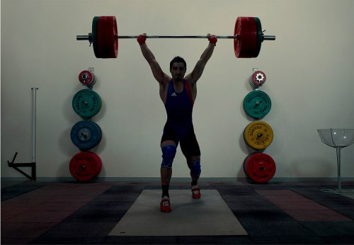 athlete silhouettes shadow fitness gym workout training sports candid photography weight-lifting
