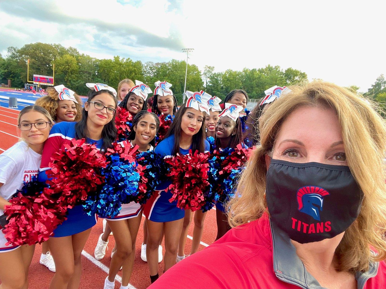 Councilwoman and Titan Alum ('89) Amy Jackson with the Lady Titans Cheerleaders at the opening game. (Courtesy photo)