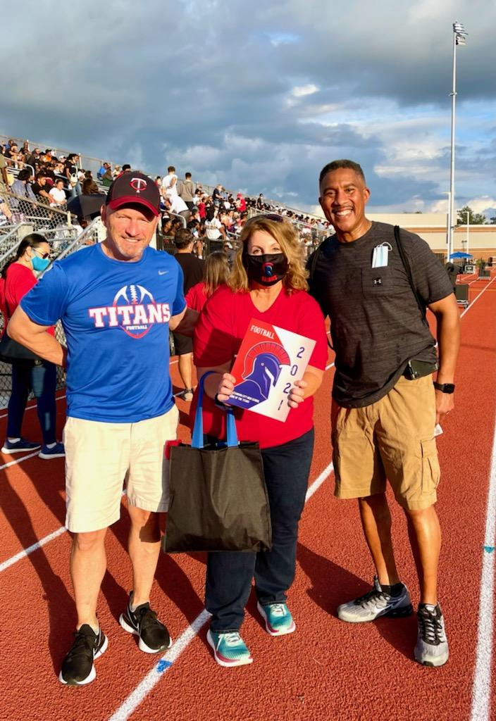 Titan Alums Alexandria Living Legend Donnie Simpson, Councilwoman Amy Jackson, and former Councilman Willie Bailey at the opening game under the new stadium lights. (Courtesy photo)
