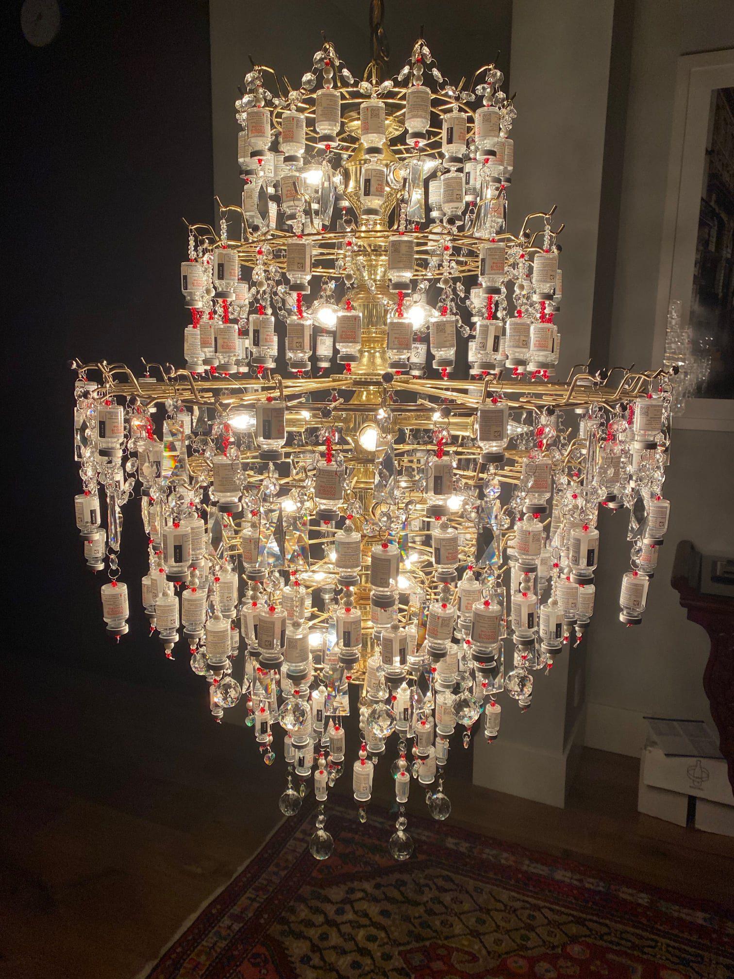 "The ""Light of Appreciation"" chandelier made of Moderna covid vaccine vials but Boulder Public Health nurse Laura Weiss. (Photo: Facebook)"