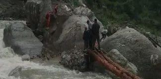 A foot bridge in Chamoli, Uttarakhand got washes away due to heavy rains. [Photo/ANI]
