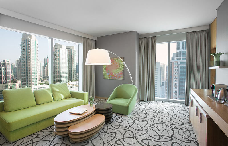 Moderne indretning med grøn sofa