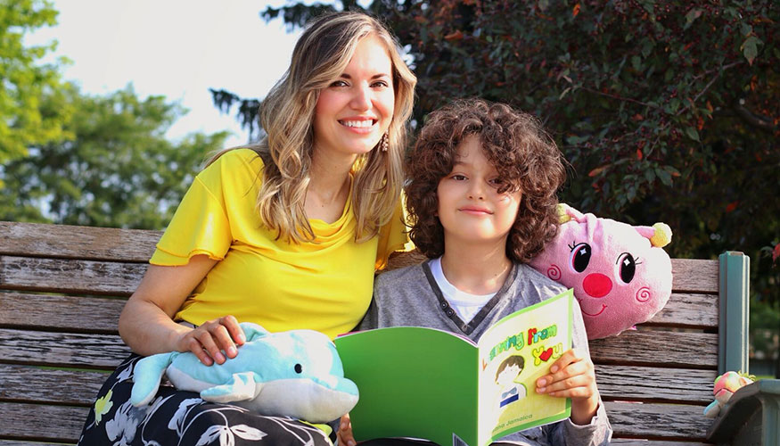 """Kenosha's Susana Jamaica reads her children's book """"Learning From You"""" to her son Lincoln. Jamaica, a native of Mexico, is a local paralegal and product of the Kenosha Literacy Council."""