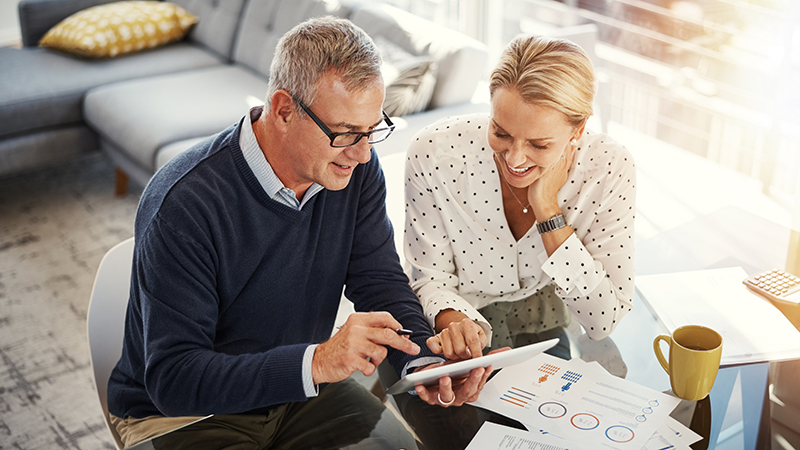 Mature couple reviewing finances together